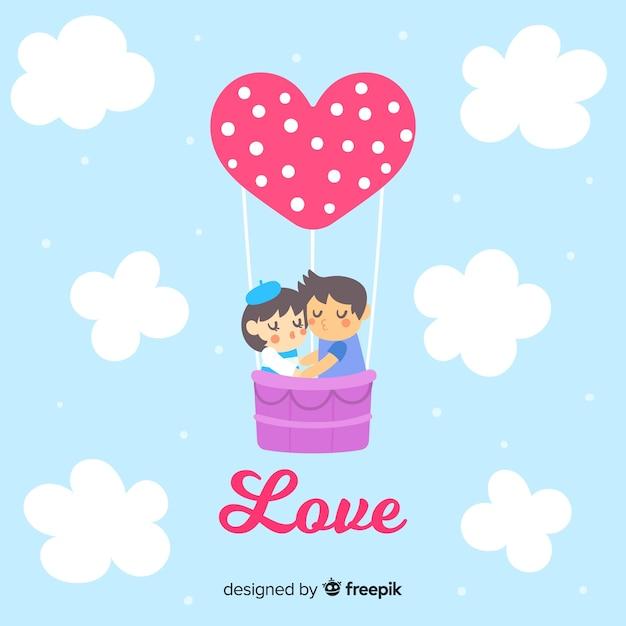熱気球のバレンタインの背景にカップル 無料ベクター