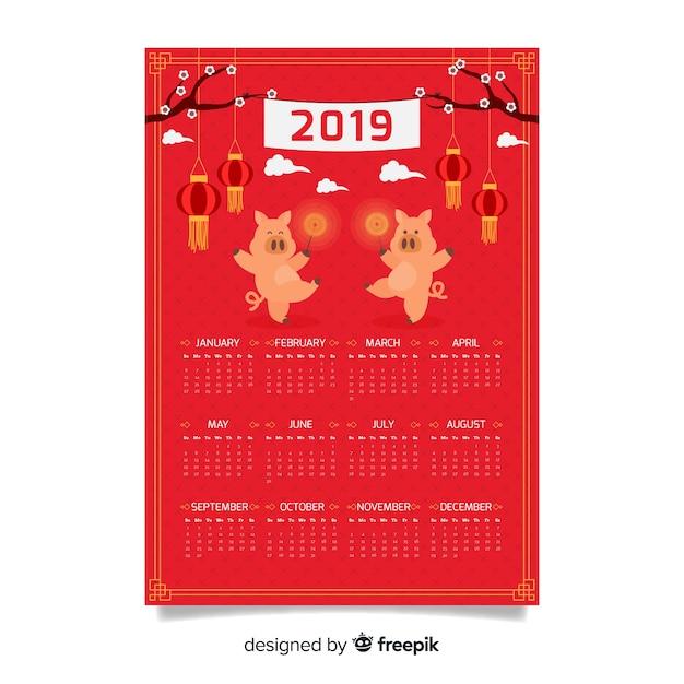 豚を踊る中国の新年カレンダー 無料ベクター