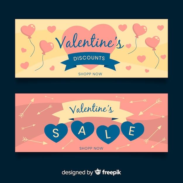 風船と矢のバレンタインセールのバナー 無料ベクター