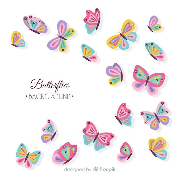 フラット蝶の背景を飛んで 無料ベクター