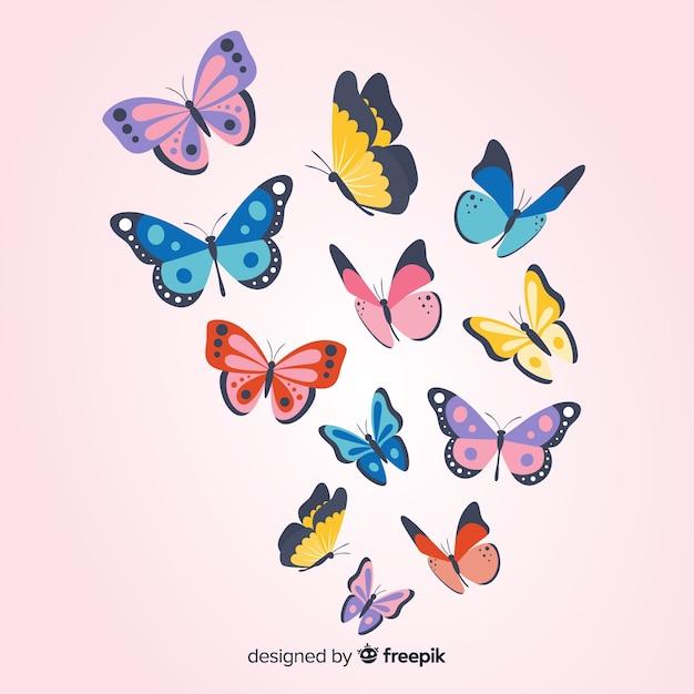 Плоские бабочки летают Бесплатные векторы
