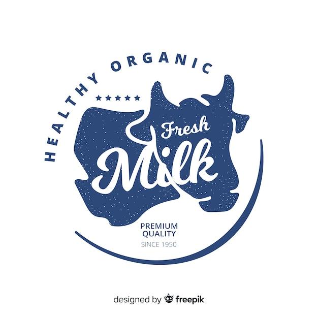 有機牛乳のロゴの背景 無料ベクター