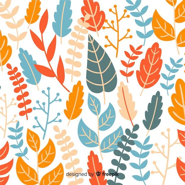 カラフルな手描きの葉の背景 無料ベクター