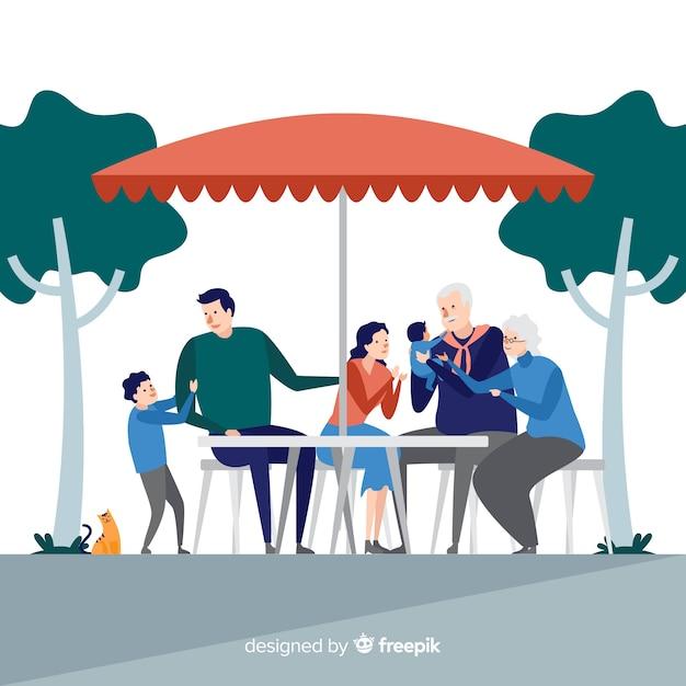 手描き家族一緒に屋外で食べること 無料ベクター