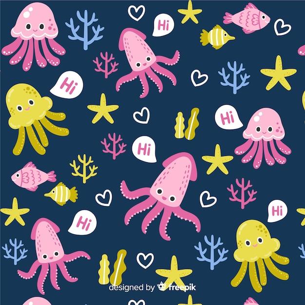 カラフルな落書き海の動物と言葉のパターン 無料ベクター