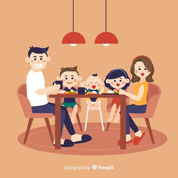 テーブルの図の周りに座って手描き家族 無料ベクター