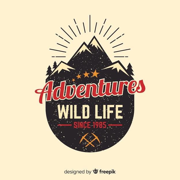 ビンテージの冒険のロゴの背景 無料ベクター
