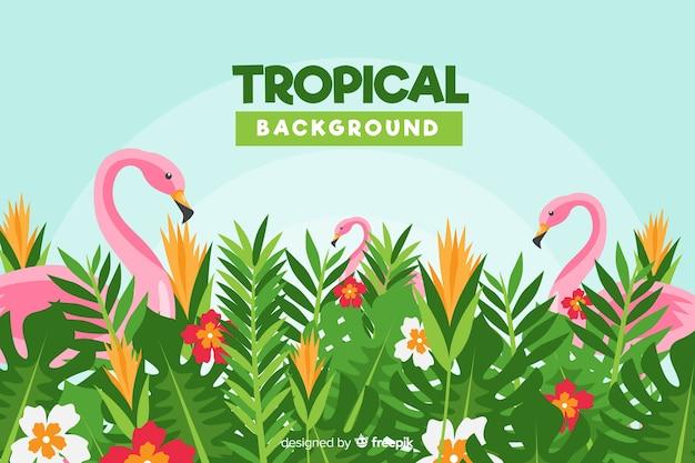 平らな熱帯の花とフラミンゴの背景 無料ベクター