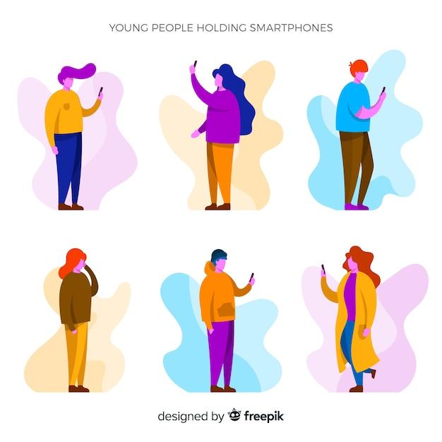 スマートフォンセットを使用して手描きの若い人たち 無料ベクター
