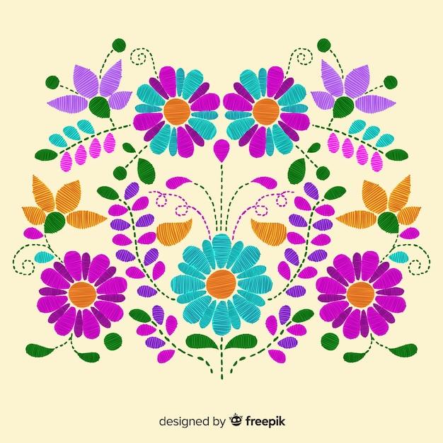 Вышивка мексиканским цветочным фоном Бесплатные векторы