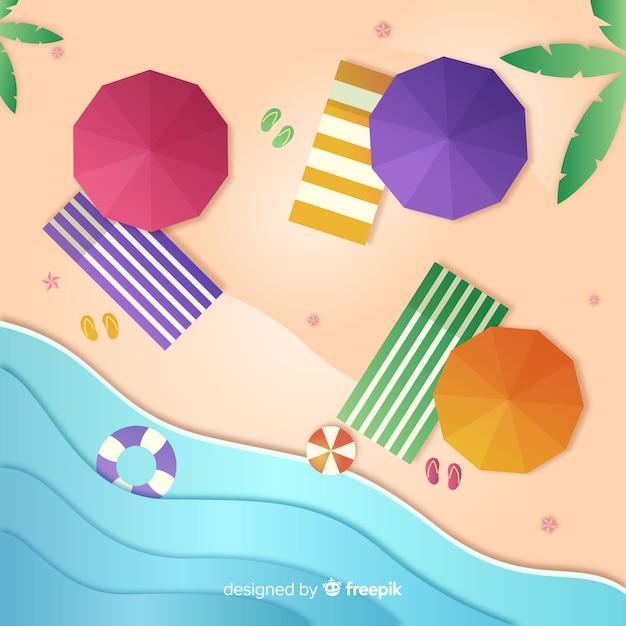 Вид сверху на пляж в бумажном стиле Бесплатные векторы