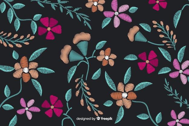 刺繍の花の背景 無料ベクター