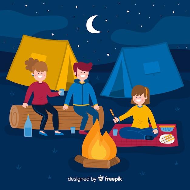 夜にキャンプの人々と背景 無料ベクター