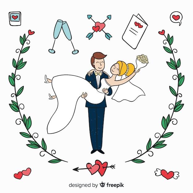 手描きの結婚式のカップルの装飾品 無料ベクター