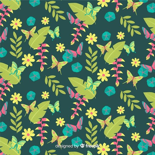 平らな熱帯の葉と花の背景 無料ベクター