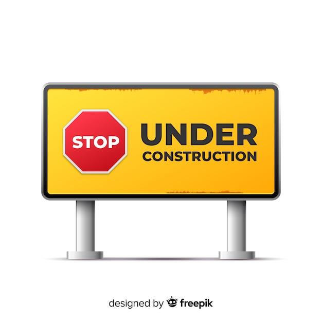 黄色の工事中のリアルなサイン 無料ベクター