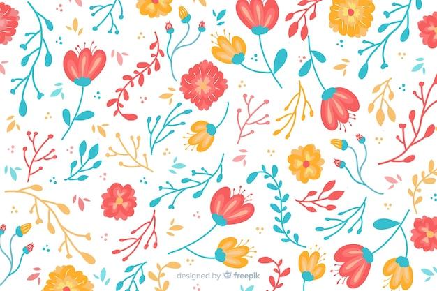 Естественный фон с рисованной цветами Бесплатные векторы