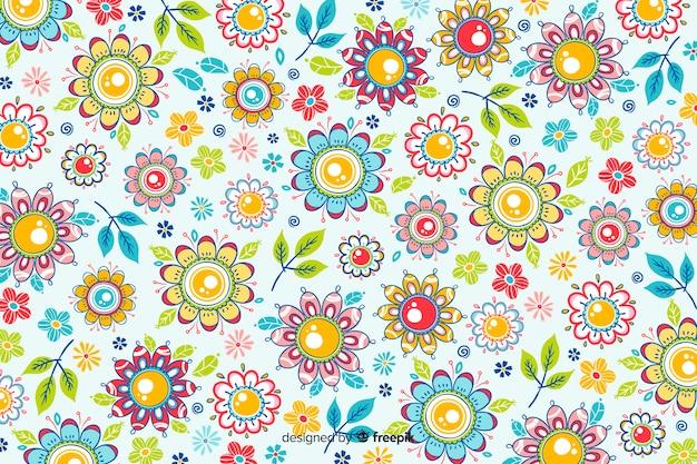 手描きの花と自然な背景 無料ベクター