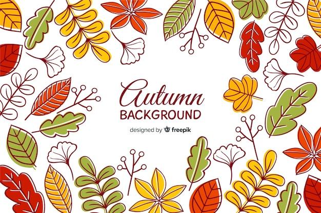 手描きの秋の背景と葉 無料ベクター