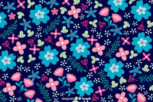 色とりどりの花の背景フラットスタイル 無料ベクター
