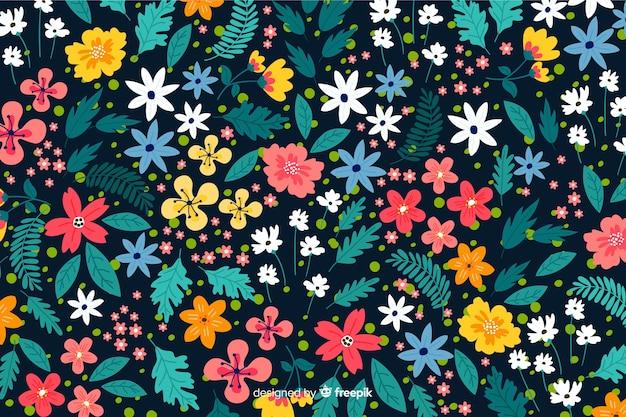 色とりどりの花の背景フラットデザイン 無料ベクター