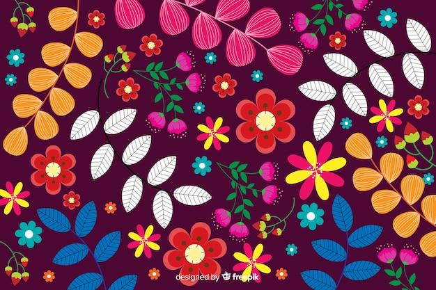 平らなカラフルな花と葉の背景 無料ベクター