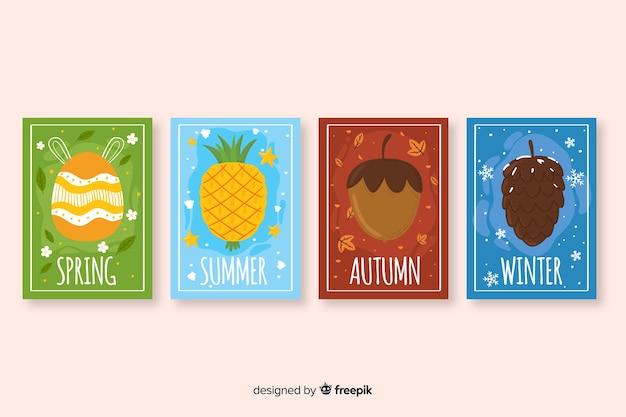 Ручной обращается коллекция сезонных плакатов Бесплатные векторы