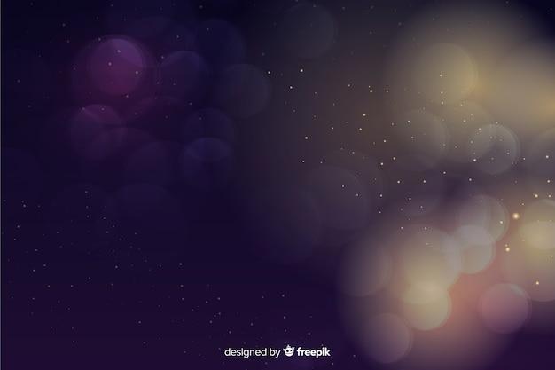 Роскошный фон с золотыми и синими частицами боке Бесплатные векторы