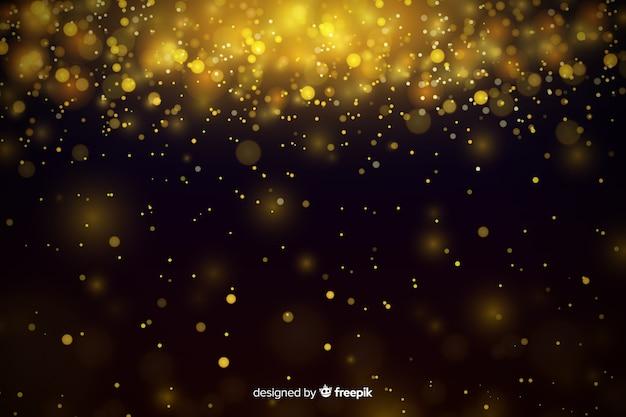 Роскошный фон с золотыми частицами боке Бесплатные векторы
