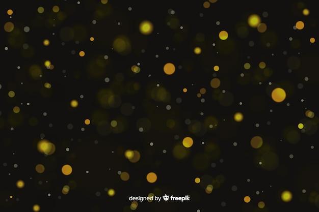 金色の粒子のボケ味を持つ豪華な背景 無料ベクター