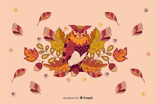 フクロウと手描きの秋の背景 無料ベクター
