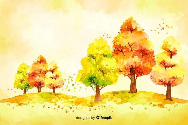 Акварель осеннее дерево и листья фон Бесплатные векторы