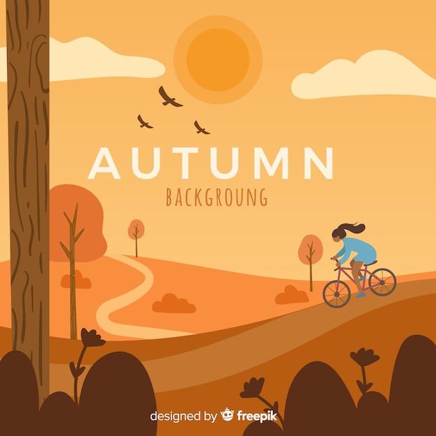 Девушка езда на велосипеде на фоне осени Бесплатные векторы