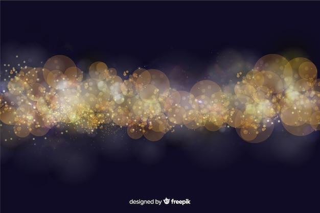 Боке фон с золотыми частицами Бесплатные векторы