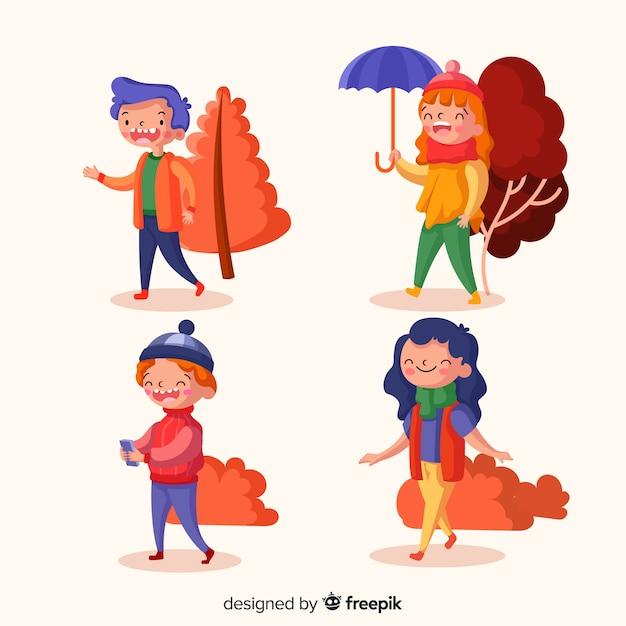 Разные люди гуляют осенью Бесплатные векторы
