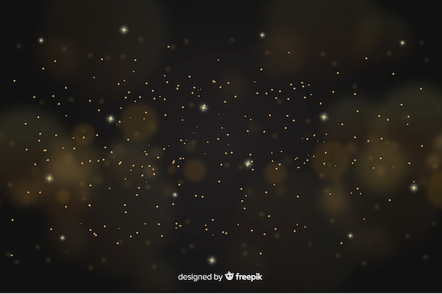 金色の粒子と金色の背景 無料ベクター