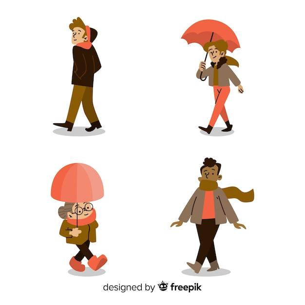 秋を歩く人のセット 無料ベクター