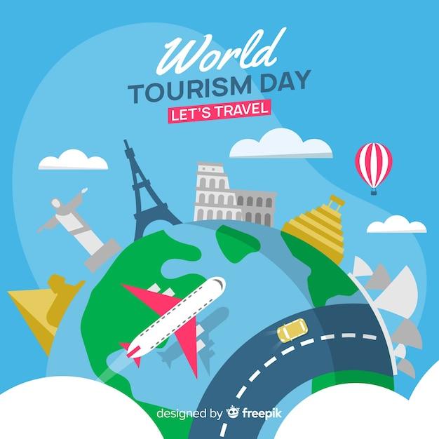 Плоский всемирный день туризма фон с достопримечательностями Бесплатные векторы