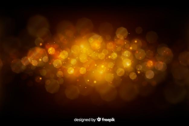 黄金の粒子と豪華な背景 無料ベクター