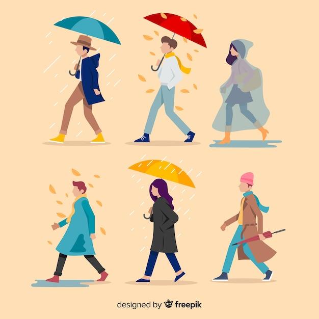 秋に歩いている平らな人々 無料ベクター