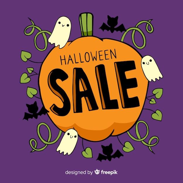 Ручной обращается хэллоуин продажа с тыквой Бесплатные векторы
