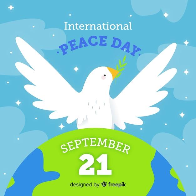 Ручной обращается день мира в сентябре Бесплатные векторы