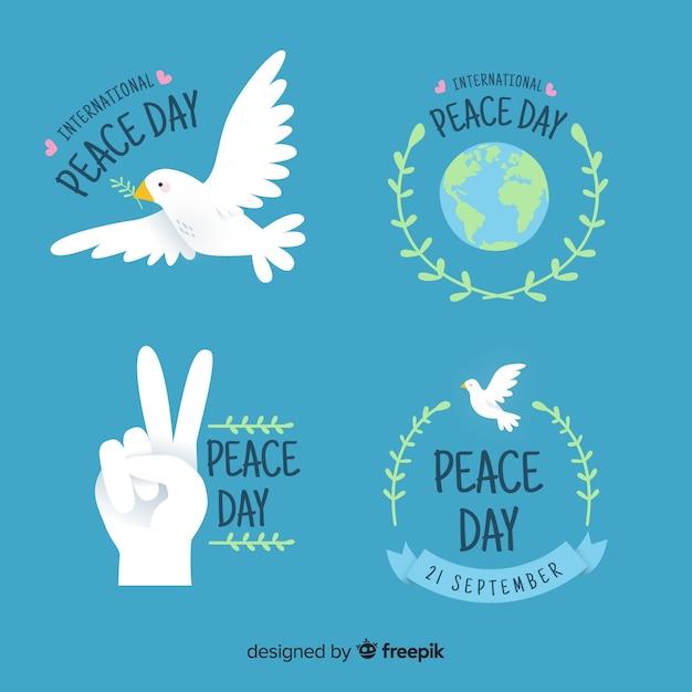 手描きの平和の日ラベルコレクション 無料ベクター