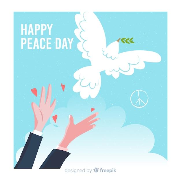 鳩と手描きの平和の日の背景 無料ベクター