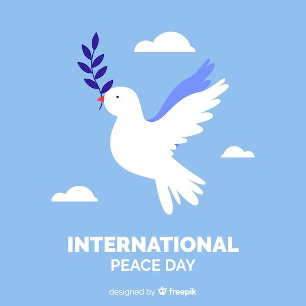 鳩と平らな平和の日の背景 無料ベクター