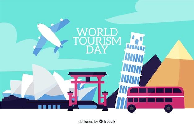 Плоский всемирный день туризма с транспортом и достопримечательностями Бесплатные векторы
