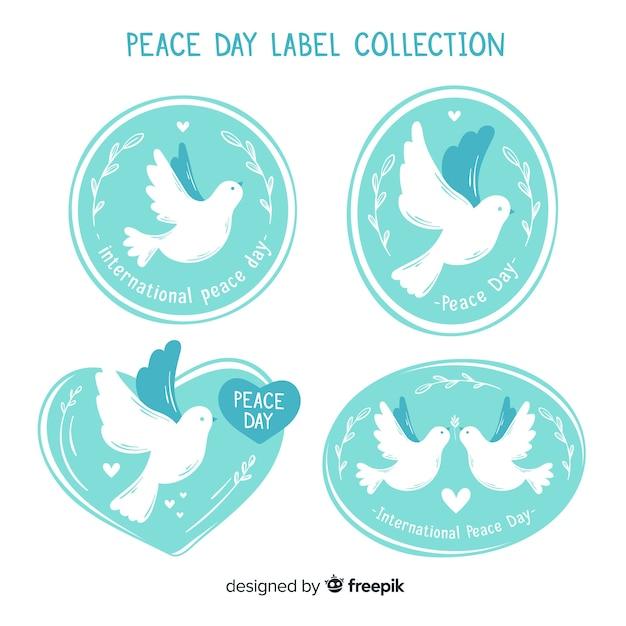 手描きの平和の日鳩バッジコレクション 無料ベクター