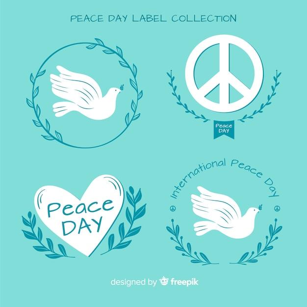 手描きの平和の日のラベルとバッジのコレクション 無料ベクター