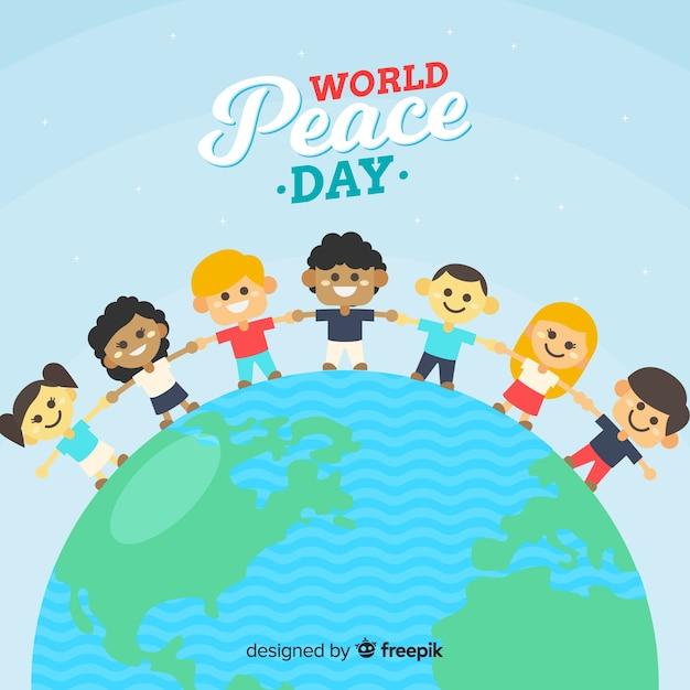 手を繋いでいる子供たちと手描きの平和の日 無料ベクター