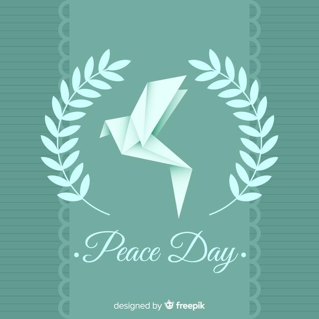 Международный день мира с голубем оригами Бесплатные векторы